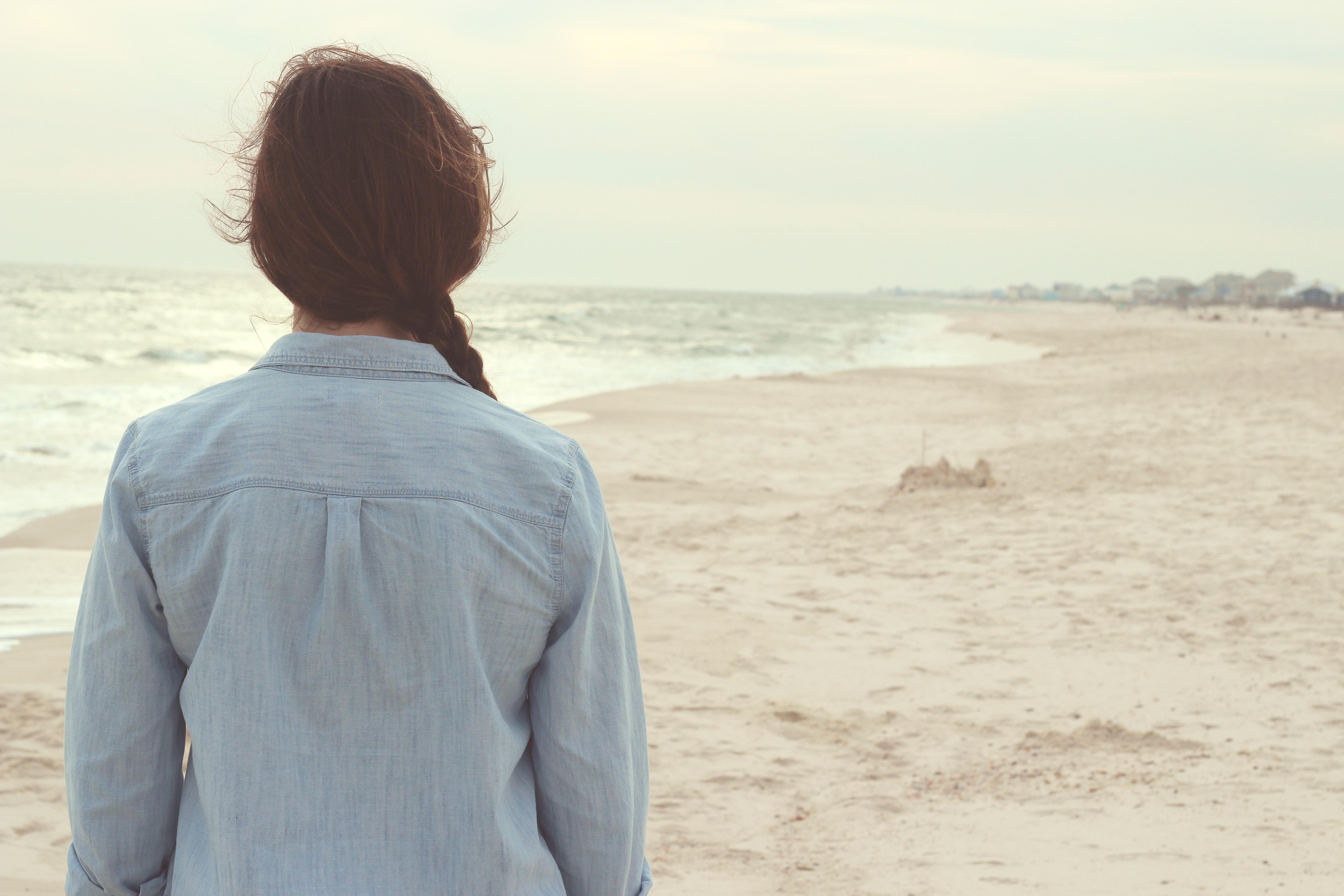 Dark-haired woman on sandy beach